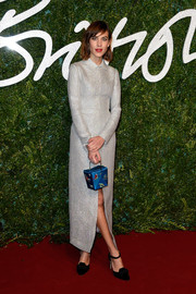 Alexa Chung added a touch of color with a blue Charlotte Olympia Take Me Away purse.