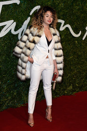 For a more glamorous finish, Ella Eyre layered a striped fur coat over her suit.