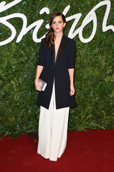 Emma Watson looked perfectly put together, as always, in a navy Dior coat layered over a white Misha Nonoo jumpsuit at the British Fashion Awards.