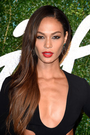 Joan Smalls wore her long hair down in a side sweep during the British Fashion Awards.