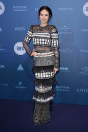 Olga Kurylenko worked an edgy-glam vibe in this studded and feathered column dress by Balmain at the British Independent Film Awards.