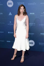 Ruth Wilson jazzed up her simple dress with mismatched evening sandals, also by Calvin Klein.