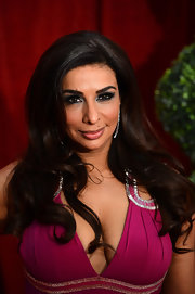 Strong brows, full false lashes and smoky charcoal shadow created a dramatic make-up look for Shobna at the 2012 British Soap Awards.