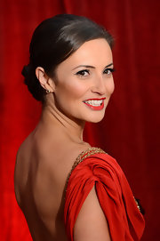 Alexis Peterman styled her hair in a sleek classic bun with side-swept bangs for the 2012 British Soap Awards.