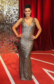Kym Lomas glittered on the British Soap Awards red carpet in a beaded silver evening dress.