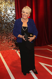 Meg Johnson layered a sequined blue jacket over a black gown for her British Soap Awards red carpet look.