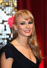 Holly Weston wore her hair in billowy waves, complete with a flower clip, for an Old Hollywood feel at the British Soap Awards.