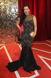 Shona McGarty exuded vintage elegance at the British Soap Awards in an intricately beaded sheer-panel black gown.