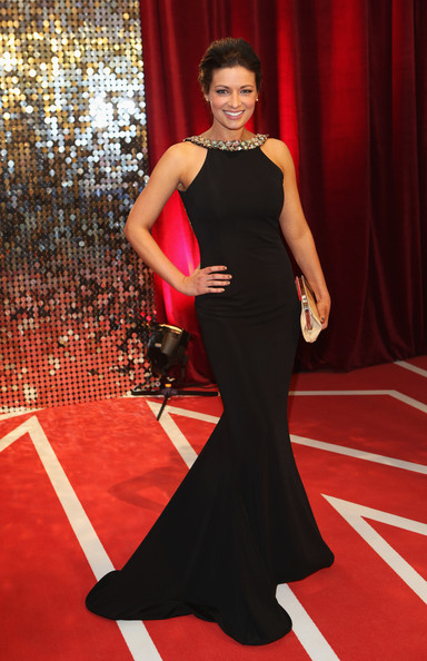 Sophie Austin cut a shapely figure in this black mermaid gown with an embellished neckline.