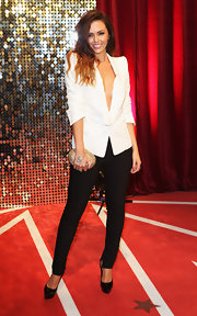 Jennifer Metcalfe paired black skinny pants with a pointy-shouldered blazer for a fiercely chic look during the British Soap Awards.