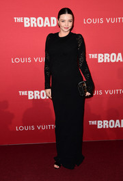 Miranda Kerr looked simply elegant in a black Louis Vuitton gown with lace sleeves at the celebration of Jasper Johns: 'Something Resembling Truth.'
