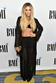 Rachel Platten accessorized her look with a gold and black tube clutch.