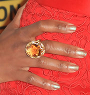 Regina King's massive gemstone ring provided a nice color contrast to her dress at the Critics' Choice Awards.