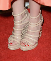 Lizzy Caplan added a cool modern touch to her red carpet look with these nude strappy wedges.