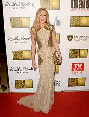 Cat Deeley looked like a golden goddess in this two-toned gold gown that featured a structured waist and sequined panels.