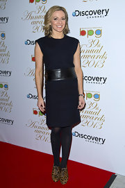 Gabby Logan opted for a classic navy cocktail dress with a wide black belt for her red carpet look at the Broadcasting Press Guild TV and Radio Awards.