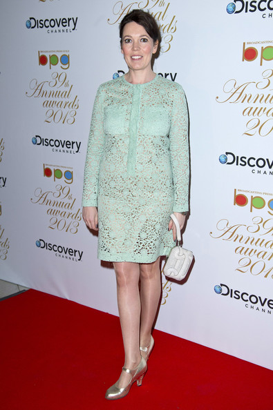 Olivia Colman opted for a pastel sea foam green lace dress for her red carpet look.