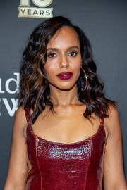 Kerry Washington accentuated her full lips with a dramatic berry hue.