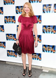 Patricia Clarkson gave her fuchsia pink cocktail dress a sexy  edge with a pair of strappy black heels. We love the heels, but the evening bag has to go.