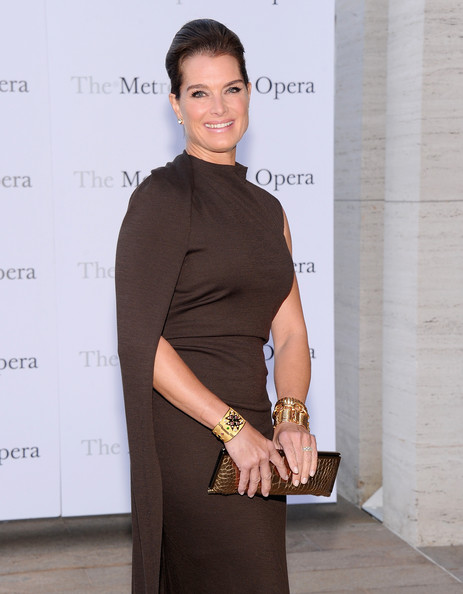 Brooke Shields Metallic Clutch [metropolitan opera season,clothing,fashion,beauty,shoulder,neck,dress,footwear,white-collar worker,waist,cocktail dress,eugene onegin,brooke shields,new york city,metropolitan opera house,production]