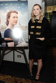 Saoirse Ronan was classic in a Burberry Prorsum military-style coat, featuring epaulets and gold embroidery, during the New York premiere of 'Brooklyn.'