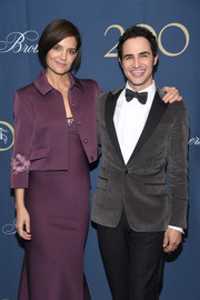 Katie Holmes arrived for the Brooks Brothers bicentennial celebration wearing a cropped plum jacket over a matching gown.