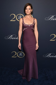 Katie Holmes was svelte and elegant in a plum-colored fishtail gown by Zac Posen at the Brooks Brothers bicentennial celebration.