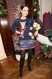 Camilla Belle looked appropriately festive in a tasseled and feathered sweater by Kate Spade at the Brooks Brothers holiday celebration.