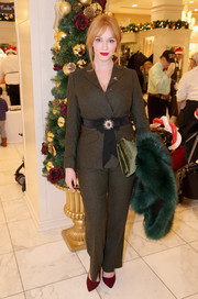Christina Hendricks opted for a brown pantsuit, which she cinched in with a bejeweled belt, when she attended the Brooks Brothers holiday celebration.