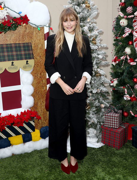 Elizabeth Olsen opted for a black wide-leg pantsuit when she attended the Brooks Brothers Holiday celebration.
