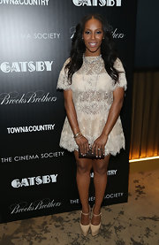 June Ambrose attended another movie screening wearing a lace dress teamed up with a super high platform Mary Janes.