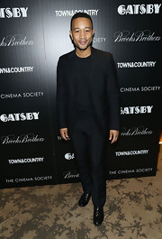 John Legend kept his look solid black from head to toe with this black suit paired over a black shirt.