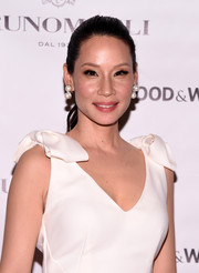 Lucy Liu polished off her look with classic dangling pearl earrings.