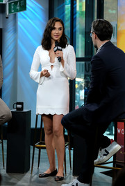 Gal Gadot was a cutie in a scalloped white mini dress by A.L.C. while visiting Build.