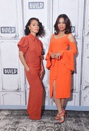 Jada Pinkett Smith donned a rust-colored Chloé button-down shirt with puffed sleeves for her visit to the Build Series.