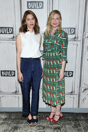Kirsten Dunst donned a vibrant print blouse by Gucci for her visit to the Build studios.