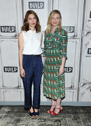 Sofia Coppola kept it girly in a collared white blouse with an embroidered yoke while visiting the Build studios.