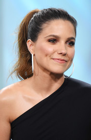 Sophia Bush looked youthful and sweet with her brushed-back ponytail while attending the Build Series.