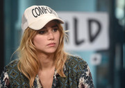 Suki Waterhouse accessorized with a 'Comfort' trucker hat while visiting the Build studios.