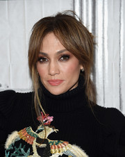Jennifer Lopez rocked a very loose bun while attending the Build Series.