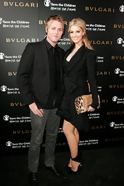 Delta Goodrem paired a leopard-print clutch with her skirt suit for a bold finish at the 125th anniversary celebration of Bulgari.