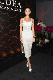 Bella Hadid looked mesmerizing in a ruched white corset dress by Dolce & Gabbana at the 'Goldea, The Roman Night' fragrance launch.