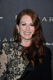 Julianne Moore showed off a sparkling pair of emerald green earrings.