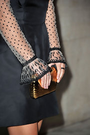 Alessandra Mastronardi's gold hard-case clutch added a dose of shine to her outfit.