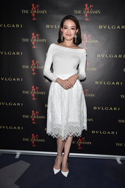 Shu Qi looked stunning with her off-the-shoulder white midi dress that featured eyelet cutouts and lace details at 'The Assassin' after screening party.