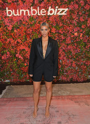 Kim Kardashian showed off her bold and unique style with this vintage Tom Ford for Gucci tux jacket teamed with cycling shorts at the Bumble Bizz Los Angeles launch.