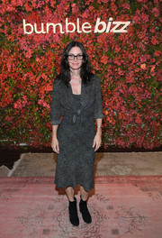 Courteney Cox chose a pair of black suede ankle boots to complete her ensemble.