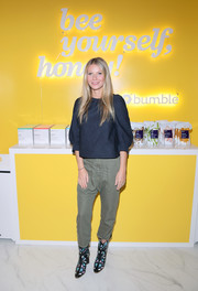 Gwyneth Paltrow paired army-green Nili Lotan capris with a navy blouse for the Bumble Hive LA debut.
