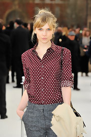 Clemence Poesy was spot on in a darling wine red polka dot top at the Burberry show.