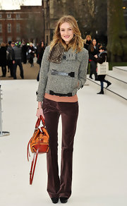 Rosie Huntington-Whiteley was a casual sophisticate in burgundy velvet trousers.